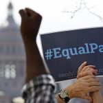 Supporters for Texas Democratic Gubernatorial candidate Wendy Davis protest outside Attorney General and Texas Republican Gubernatorial candidate Greg Abbott's office at 500 W. 15th St. Tuesday afternoon in support of equal pay for women. A spokesman for Aboott said earlier his candidate would have vetoed the Texas Equal Pay Act that guarantees equal pay for equal work for women. Senator Davis sponsored the Senate version of the Texas Equal Pay Act that made its way past the GOP led House and Senate before being vetoed by Governor Perry.   RALPH BARRERA / AMERICAN-STATESMAN